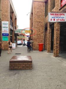 Look for the yellow signage towards the parking lot end (opposite to the fabric shops on Park Rd)